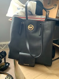 black and gold Michael Kors tote bag with matching wallet  Camillus, 13031
