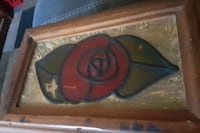 Hand-carved wooden box with a glass stain rose on it