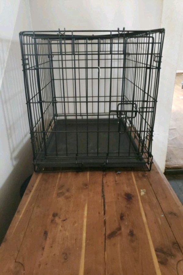 black metal folding dog crate