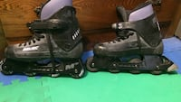 pair of gray-and-black Bauer inline skates