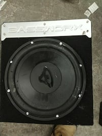black and gray subwoofer with enclosure