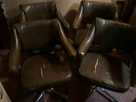4 leather look swivel rolling chairs