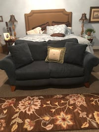 Blue loveseat sofa with throw pillows