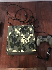 sony ps4 console with controllers