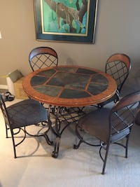 round brown wooden table with four chairs dining set Kelowna