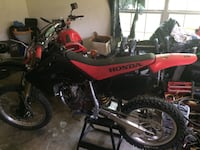 red and black Honda motocross dirt bike Bullard, 75757