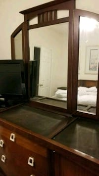 brown wooden framed mirror with mirror Centreville, 20121