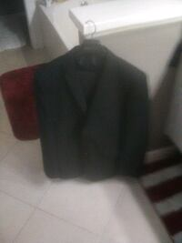Black brand new suit with vedt and garment bag
