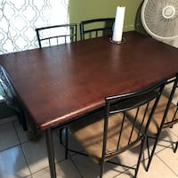 rectangular brown wooden table with four chairs dining set Houston, 77029