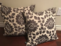 two white-and-black floral throw pillows
