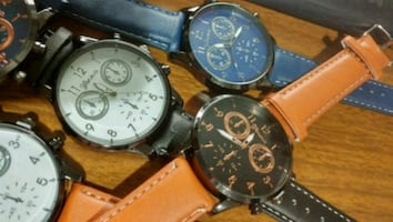round black chronograph watch with brown leather s
