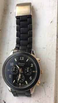 round black chronograph watch with silver link bracelet Fairmount Heights, 20743