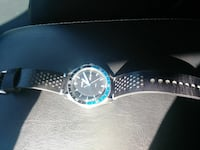 round silver chronograph watch with black leather strap 876 mi