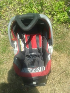 Infant black, red, and gray car seat