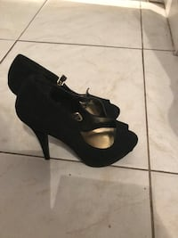 pair of black suede open-toe heeled shoes