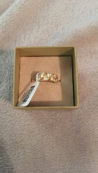 Diamond encrusted gold-colored ring
