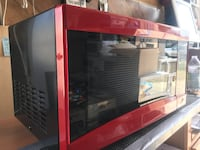 Red and Black 700 Watts microwave never been used. Los Angeles, 90064
