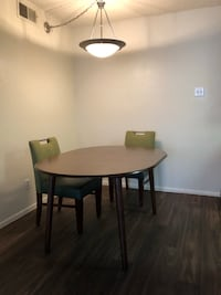 round brown wooden table with two chairs Glendale, 85304