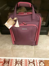 New American tourister carry on