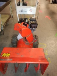 red and black Ariens snow blower