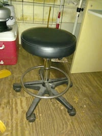Adjustable leather stool with footrest