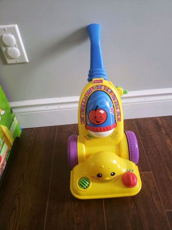 blue and yellow Fisher-Price push toy