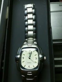 round silver-colored analog watch with link bracelet 2277 mi