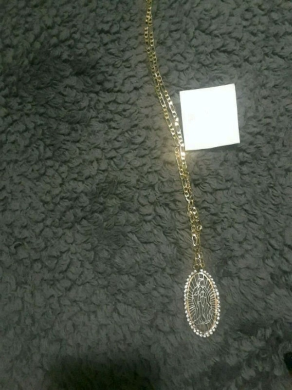 gold-colored chain necklace with pendant