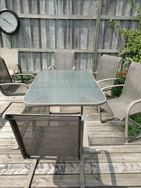 Patio set well used with rust on chairs. Ayr, N0B 1E0