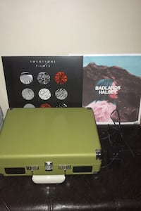 Crosley record player with two records
