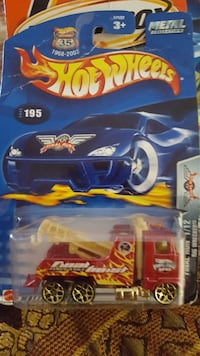 blue and yellow Hot Wheels car toy