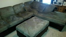 gray and black sectional couch and ottoman