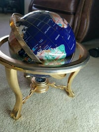 Standing globe made of gems jewels gold