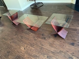 Glass tables , coffee table and two side tables.