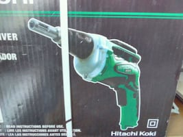 green and white corded power tool