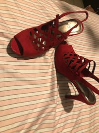 pair of red leather open-toe heeled sandals