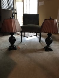 Sage green chair and two lamps with shades and base
