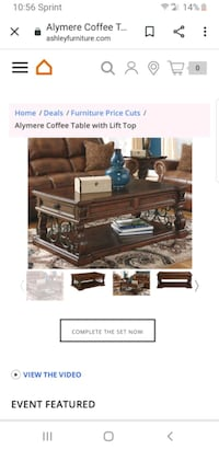 Coffee Table with lift top by Ashley