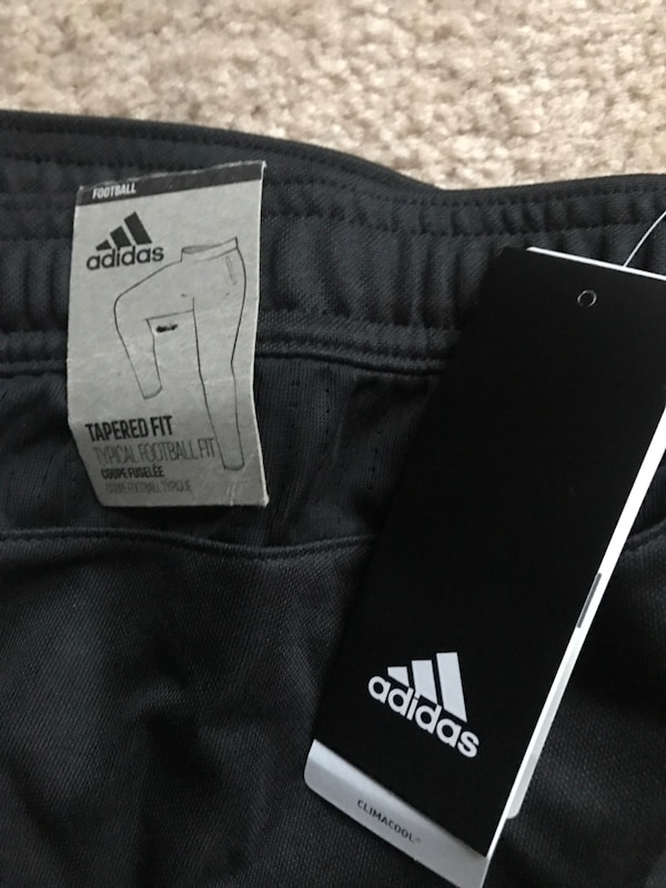 Brand new Adidas soccer training pants. Not my size which is why I'm selling it .