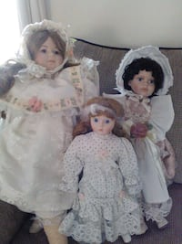 three porcelain dolls