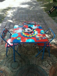 blue and red wooden table with chairs Orlando