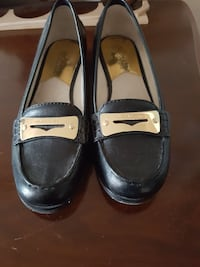 pair of black leather flat shoes