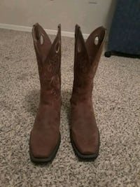 pair of brown leather square-toe cowboy boots Houston, 77057