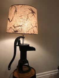 Lamp with antique water pump base