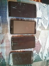 four black and gray smartphones
