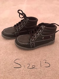 pair of black leather high-top sneakers 570 km