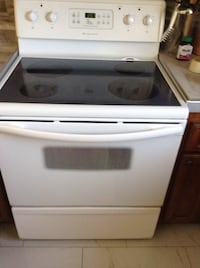white and black induction range oven Laval