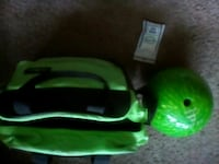 green bowling ball with black and green bag