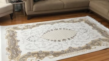 White and gray floral area rug