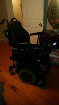 Large power wheelchair black and grey